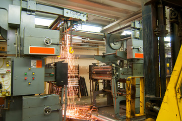 Demolition of old printing press with shower of sparks