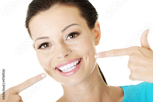 Poster Woman showing her perfect  teeth.