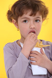 Young girl eating fries