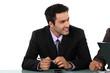 Smart businessman sitting at a desk