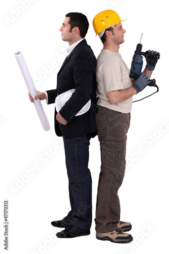 Tradesman and engineer standing back to back