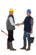 Laborers handshaking