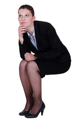 businesswoman thinking and holding her chin