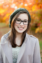 Young woman wearing glasses smiling