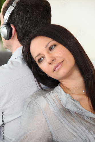 Woman leaning against her partner