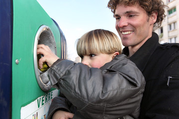 Father and son at a bottle bank