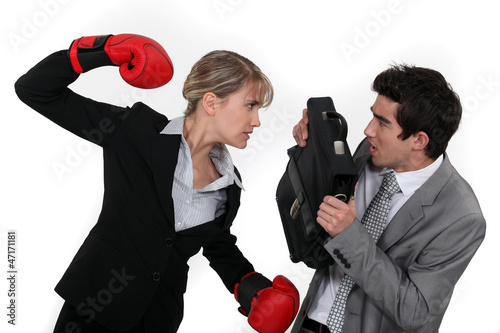 Businesswoman and businessman fighting