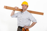 Contractor carrying timber