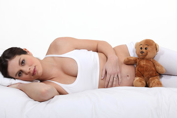 young pregnant woman in bed