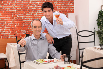 Father and son having dinner together