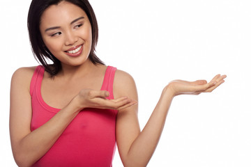 Smiling Asian woman holding out her palm