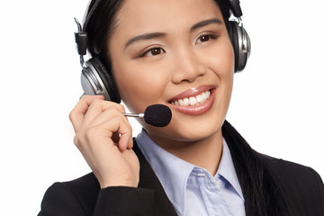 Smiling Asian call centre operator