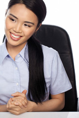 Asian businesswoman seated at her desk