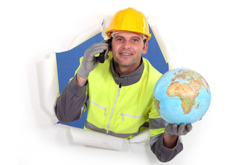 Builder holding globe and telephone