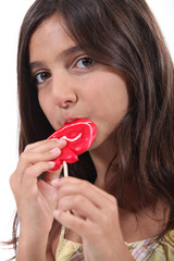 Young girl eating a lollipop
