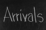 Arrivals written on blackboard background high resolution
