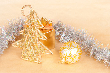 Christmas background with a ball and a tinsel