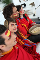 Spanish football fans watching a game at home