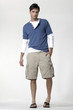 full length shot of a young man in blue shirt,