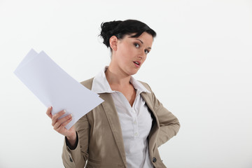 Woman holding sheets of paper