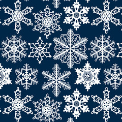 Crochet snowflakes seamless pattern on dark blue, vector