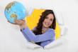 a woman showing a globe