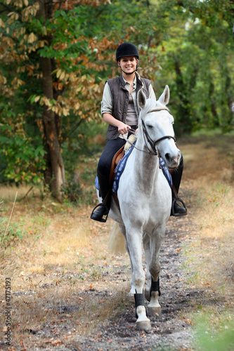 Young girl horseriding