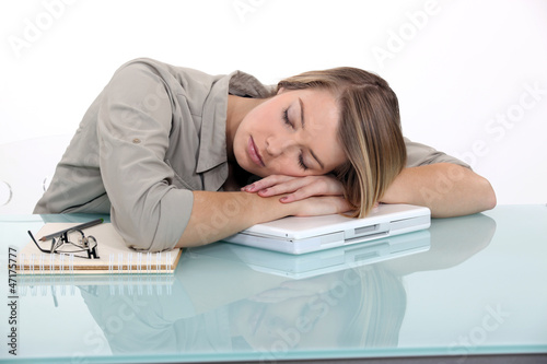 Businesswoman sleeping at work