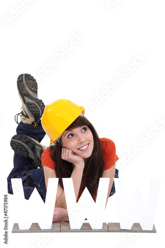 Female builder with the letters WWW