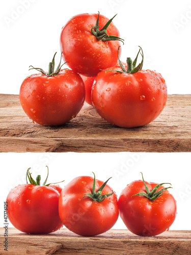 Collection of Tomatoes on the old wooden board with water drops