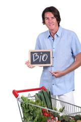 Man holding 'bio' sign