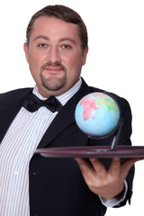 elegant man with globe on a tray
