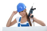 woman with drill and helmet