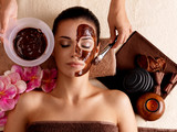 Fototapety Spa therapy for woman receiving cosmetic mask