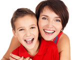laughing young mother with son 8 year old