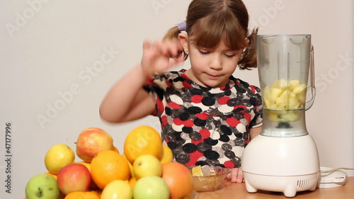 little girl make juice