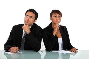 Pensive business couple