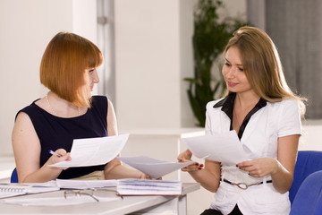 Woman advises clients in the office
