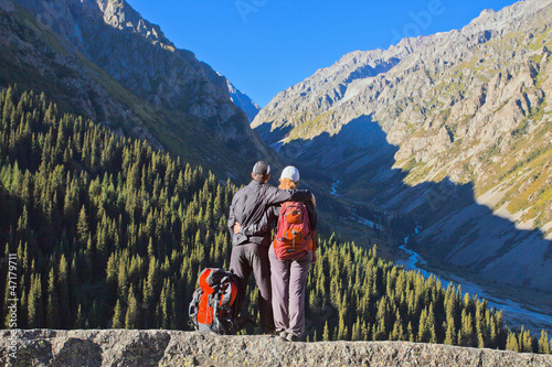 Tourist couple in Ala-Archa valley, Kyrgyzstan.