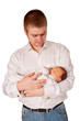Father and newborn baby. Dad cradling baby