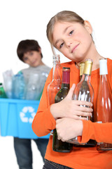 Children recycling glass bottles