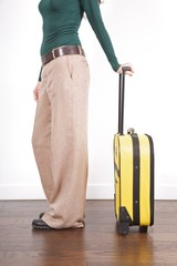 side woman with yellow suitcase