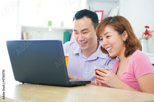 Asian couple using notebook