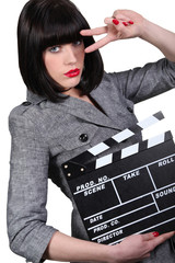Woman with a clapperboard