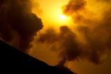 smoking volcano at sunset