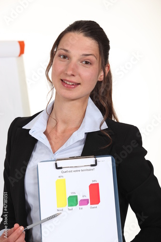 Woman holding up the results of a poll