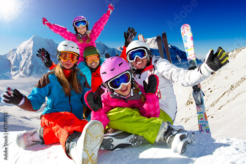 Ski, snow, sun and winter fun - happy family ski team - 47181753