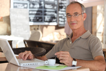 Grey-haired man in coffee shop
