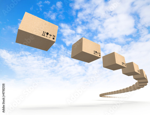 Stream of flying cardboard boxes above blue sky