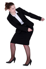 woman in a suit pulling something